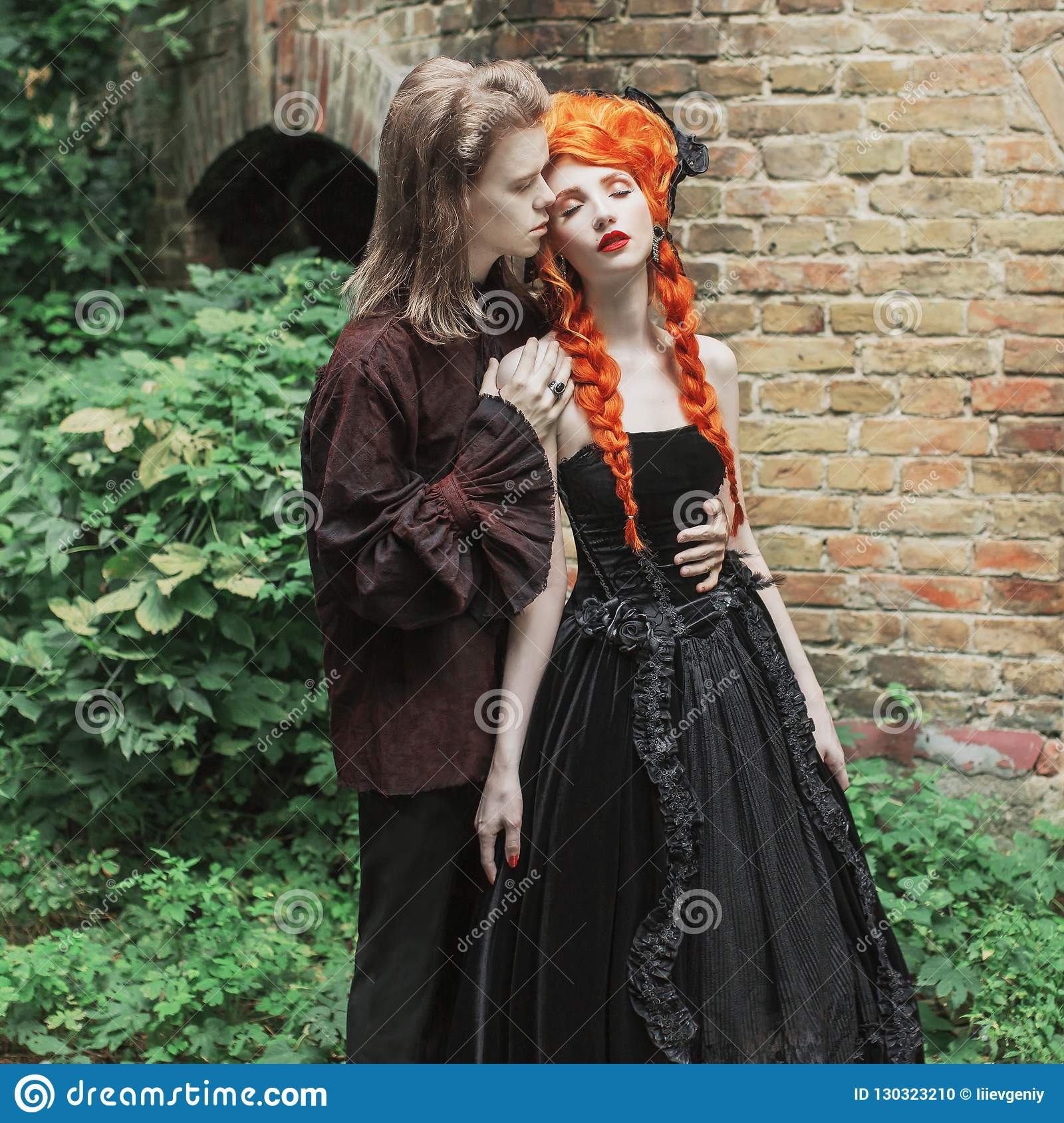 Gothic Couple Embracing In Halloween Costume Vampire In Victorian