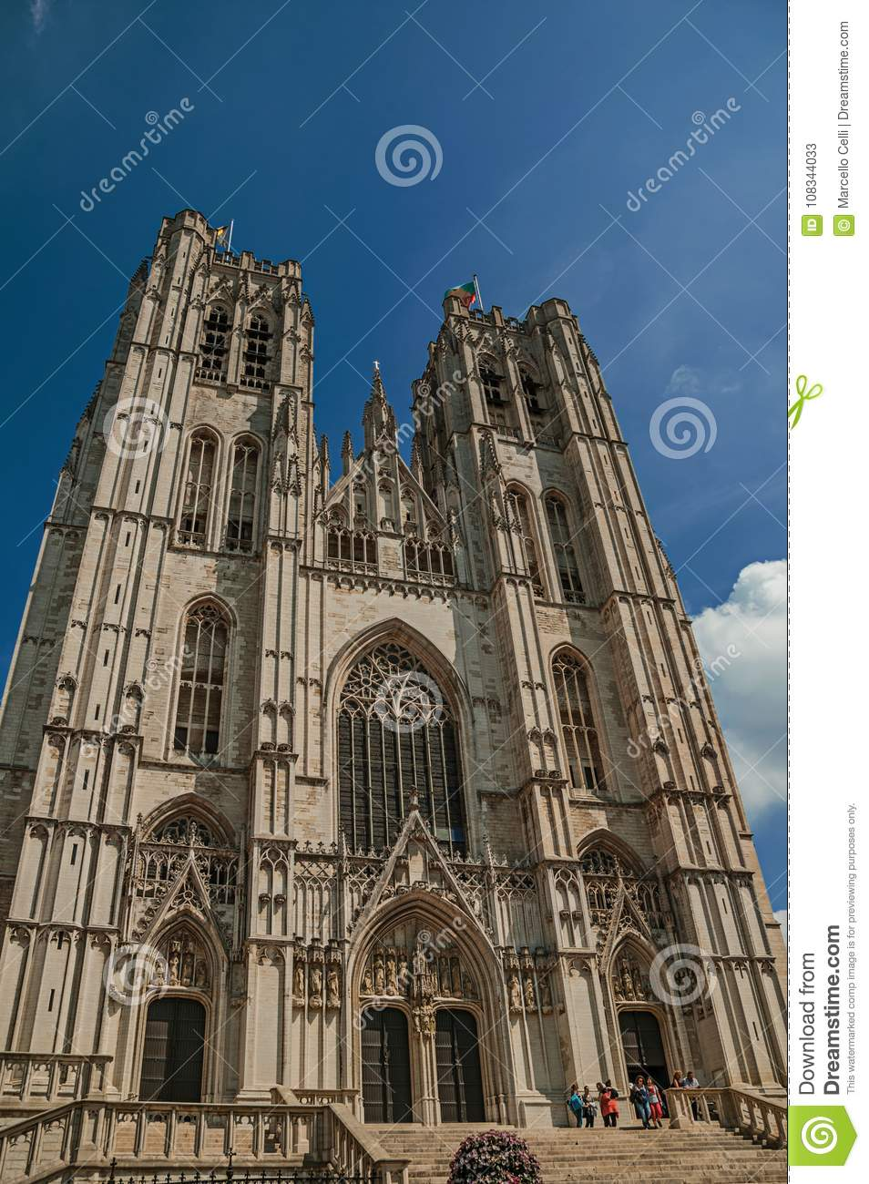 Gothic facade of St. Michael and St. Gudula's Cathedral and blue sunny sky in Brussels.