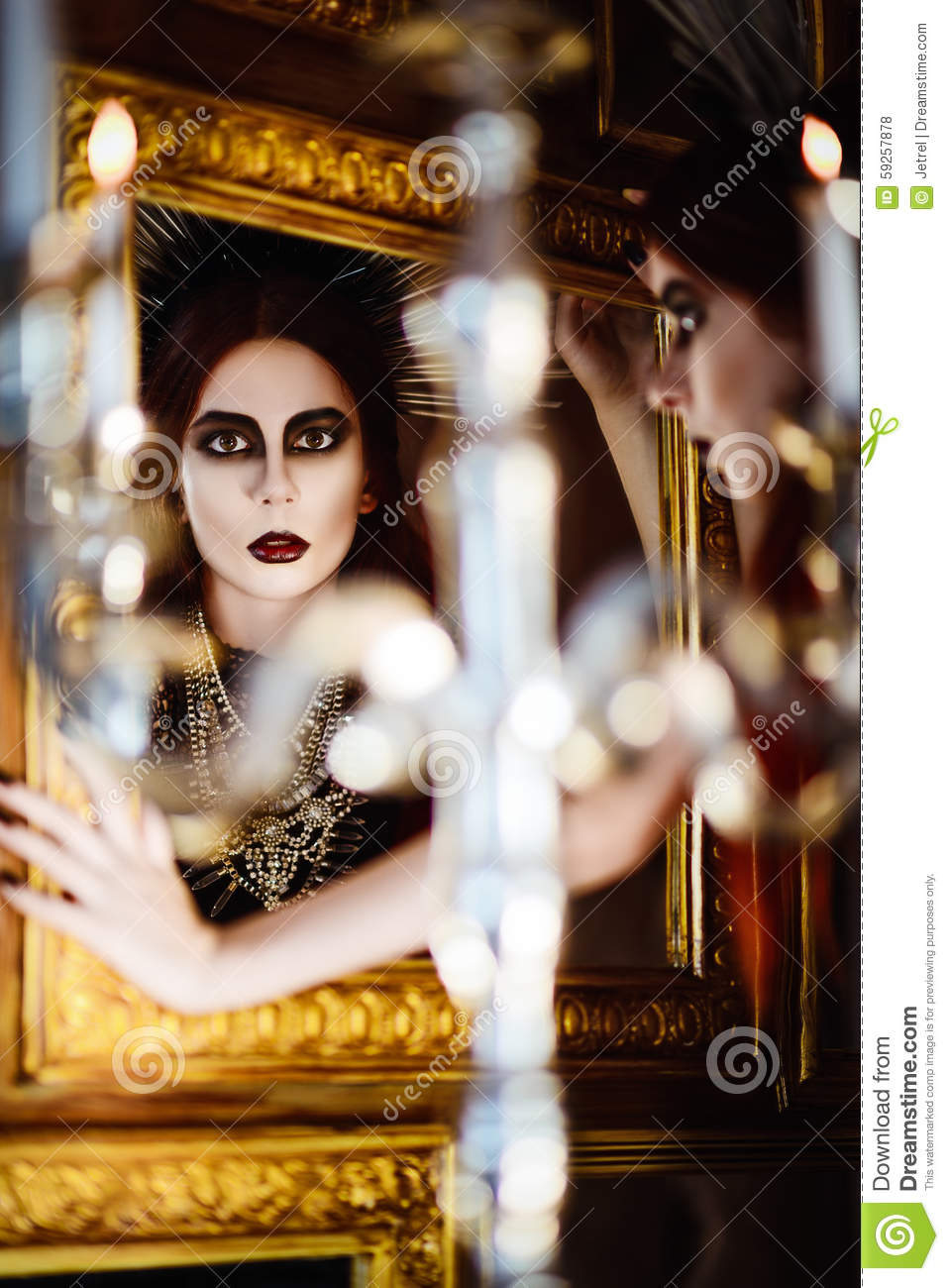 Gothic fashion mysterious beautiful young woman looking for Looking mirror