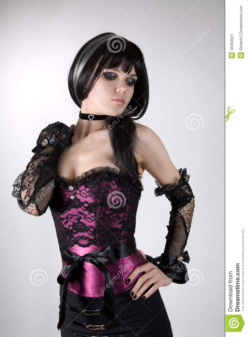 Gothic girl in purple corset and black gloves
