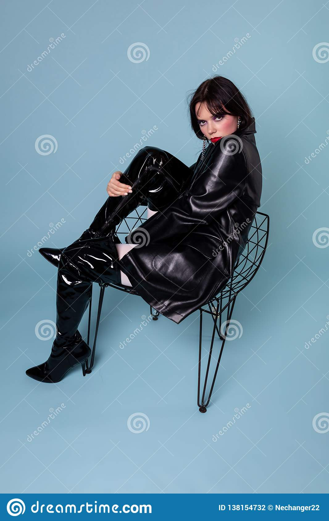 Gothic girl wearing black dress and black boots with black short hair