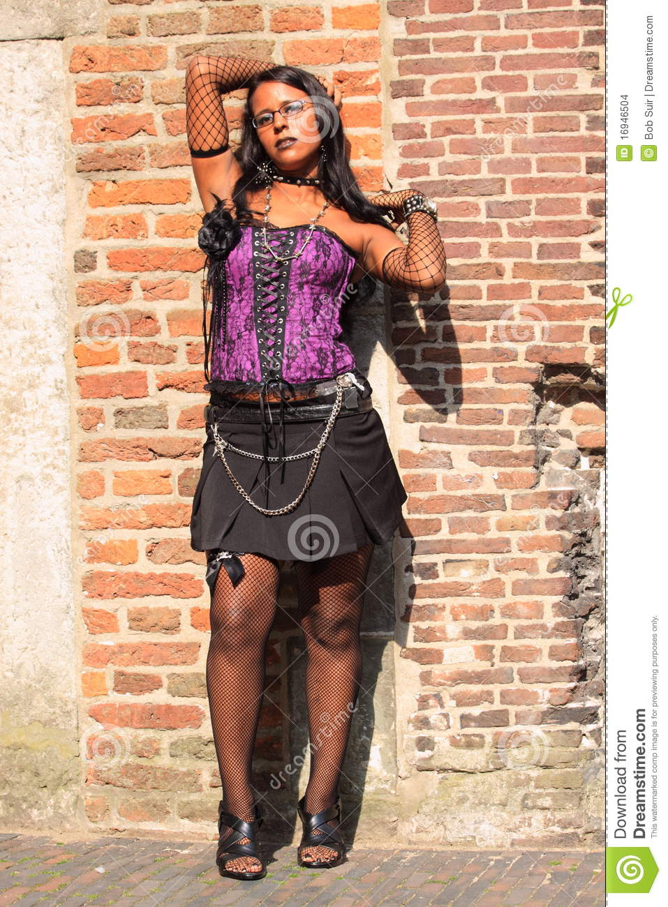 gothic girl wearing purple corset outside editorial stock