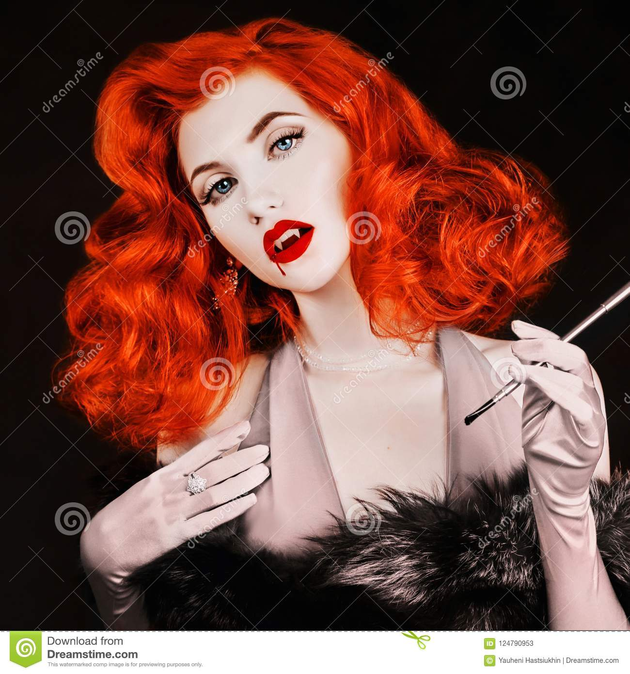 Gothic halloween attire. Vampire with open mouth and fangs. Victorian woman with pale skin on black background. Gothic redhead mod