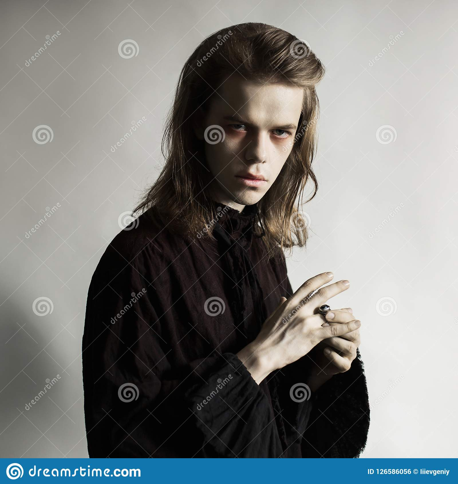 Gothic halloween clothes. Mystical conspiracy. Punk with long hair. Cunning vampire with hairdo. Spooky outfit for halloween party