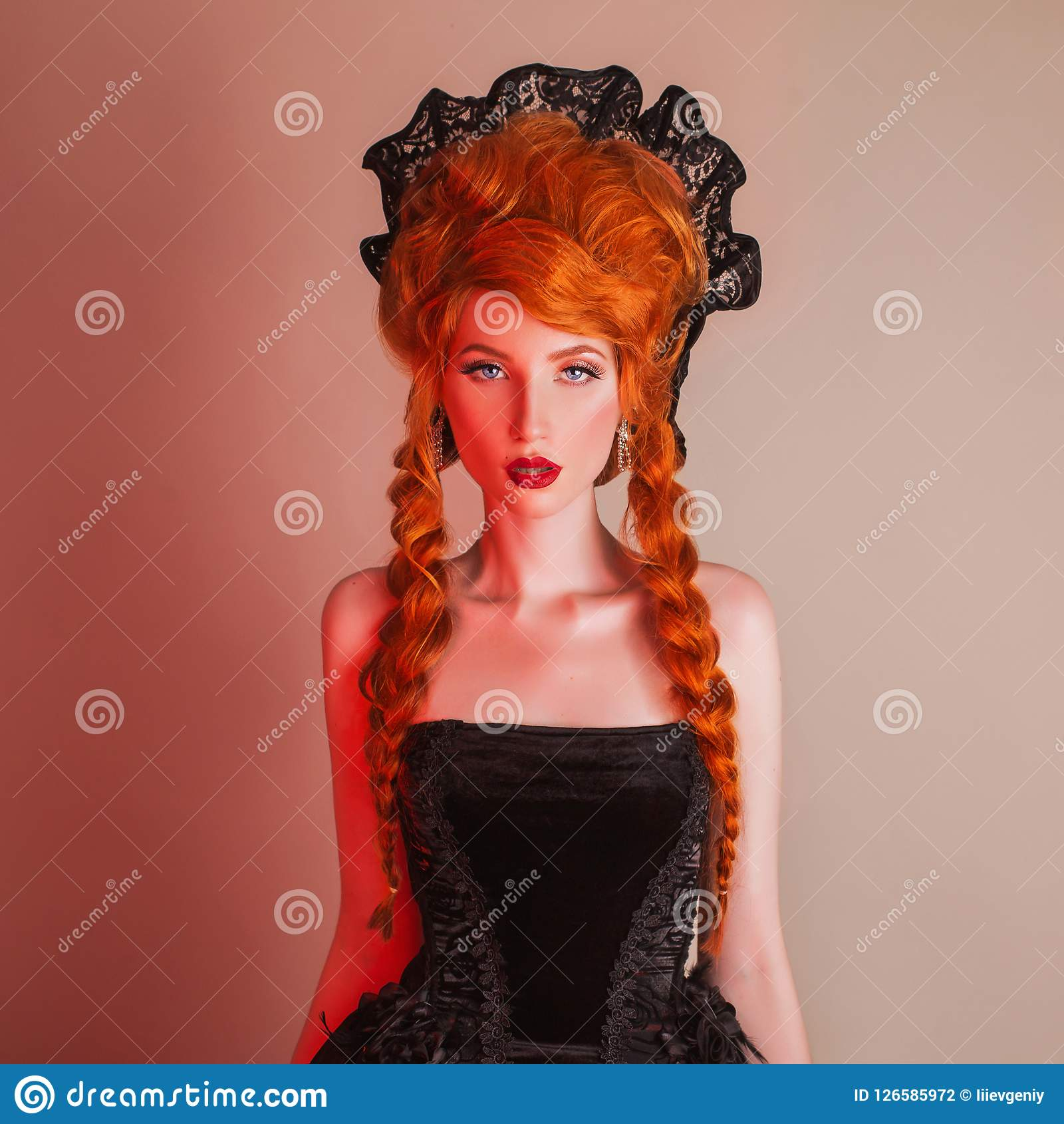Gothic halloween clothes. Young enchanting redhead queen with hairstyle. Princess with red hair. Vampire with pale skin. Mystical