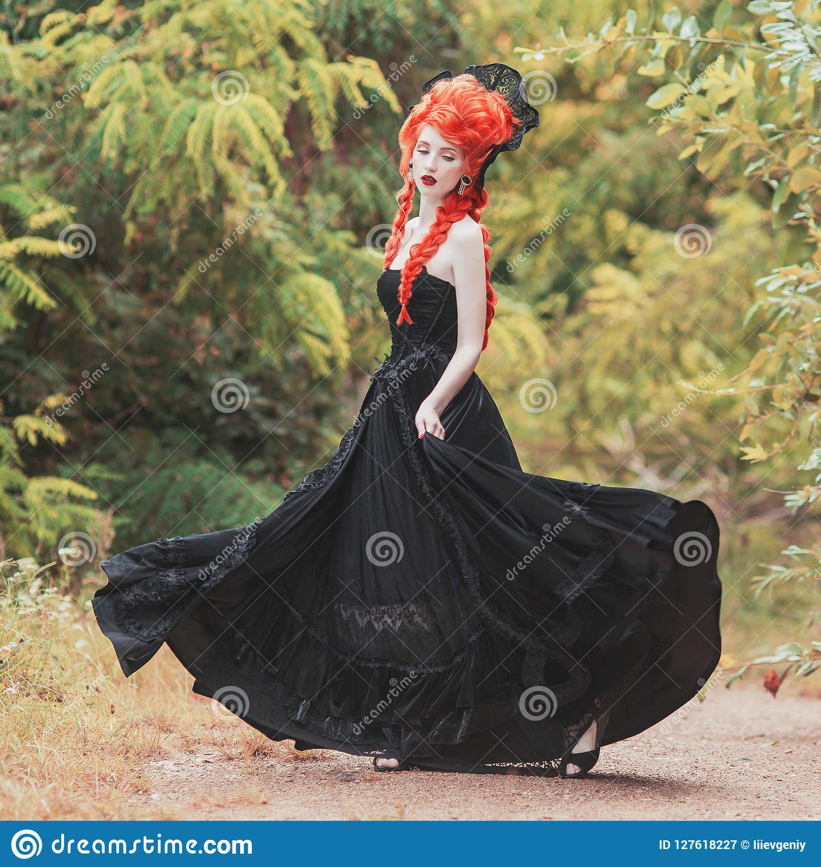 Gothic halloween clothes. Young victorian redhead queen with hairstyle. Lady with red hair. Vampire with pale skin. Victorian outf