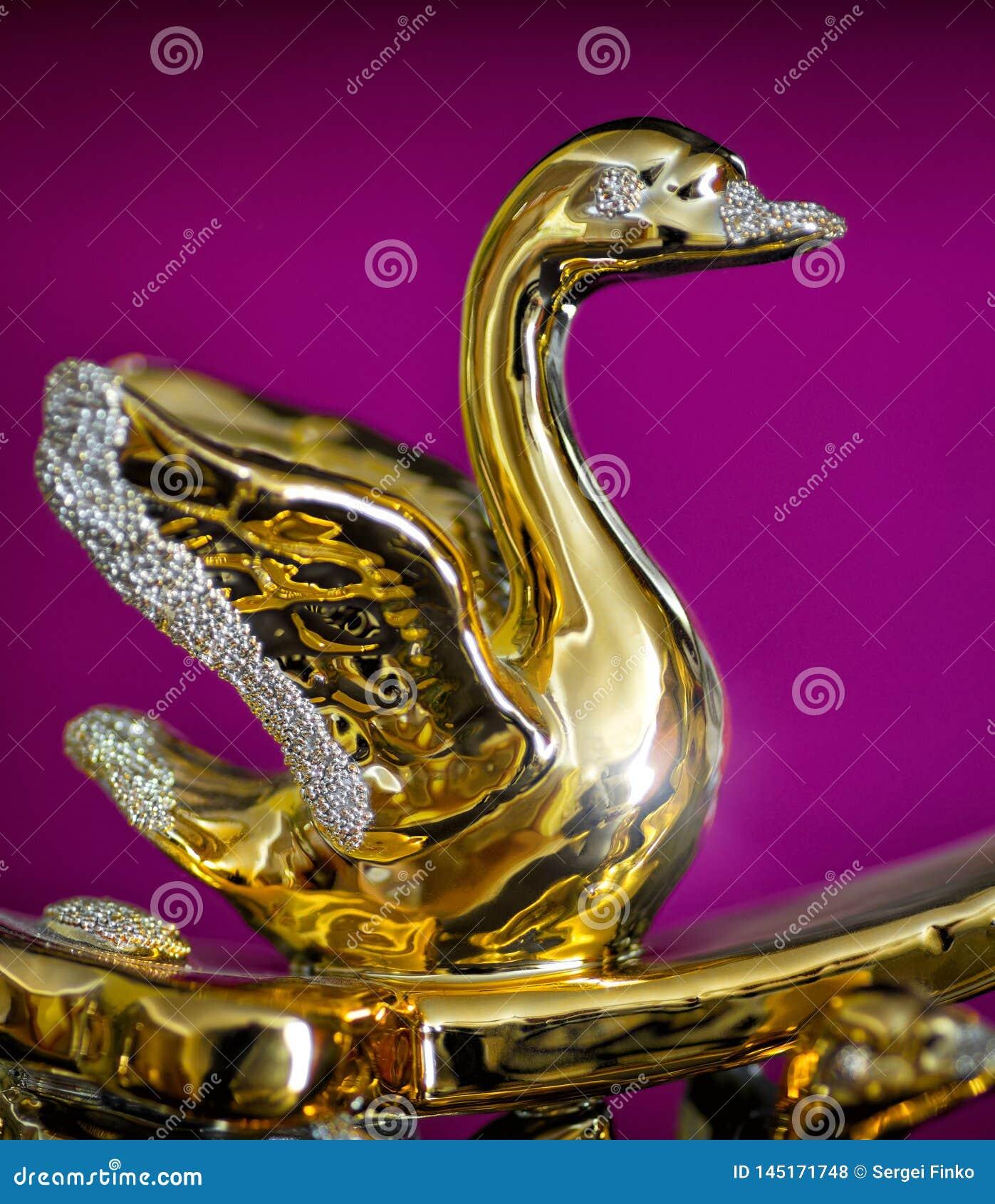 Gouden beeldje van zwaan