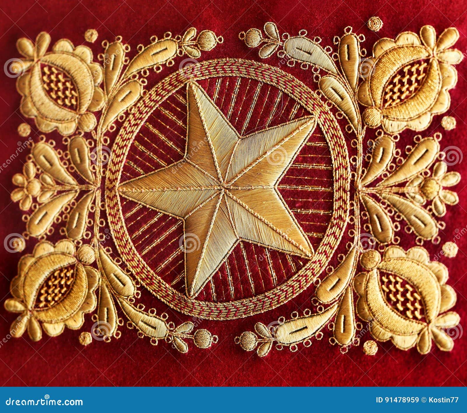Gouden borduurwerk op een stof