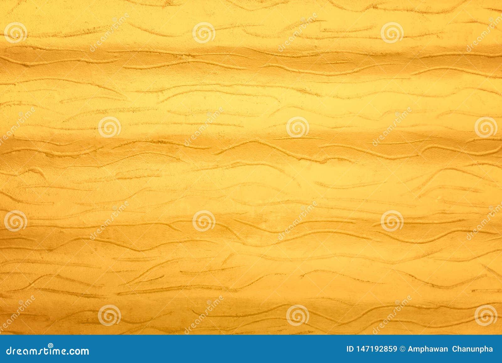 Gouden concrete muurachtergrond, aardpatronen overeenkomstig krommetextuur
