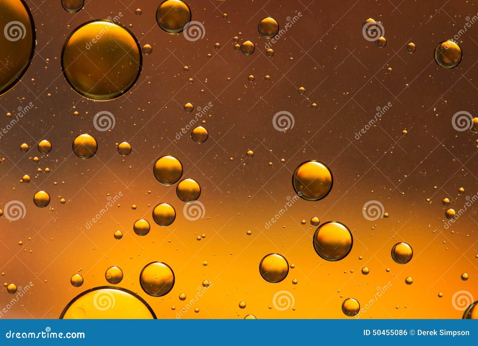 Gouden en bruine olie en watersamenvatting