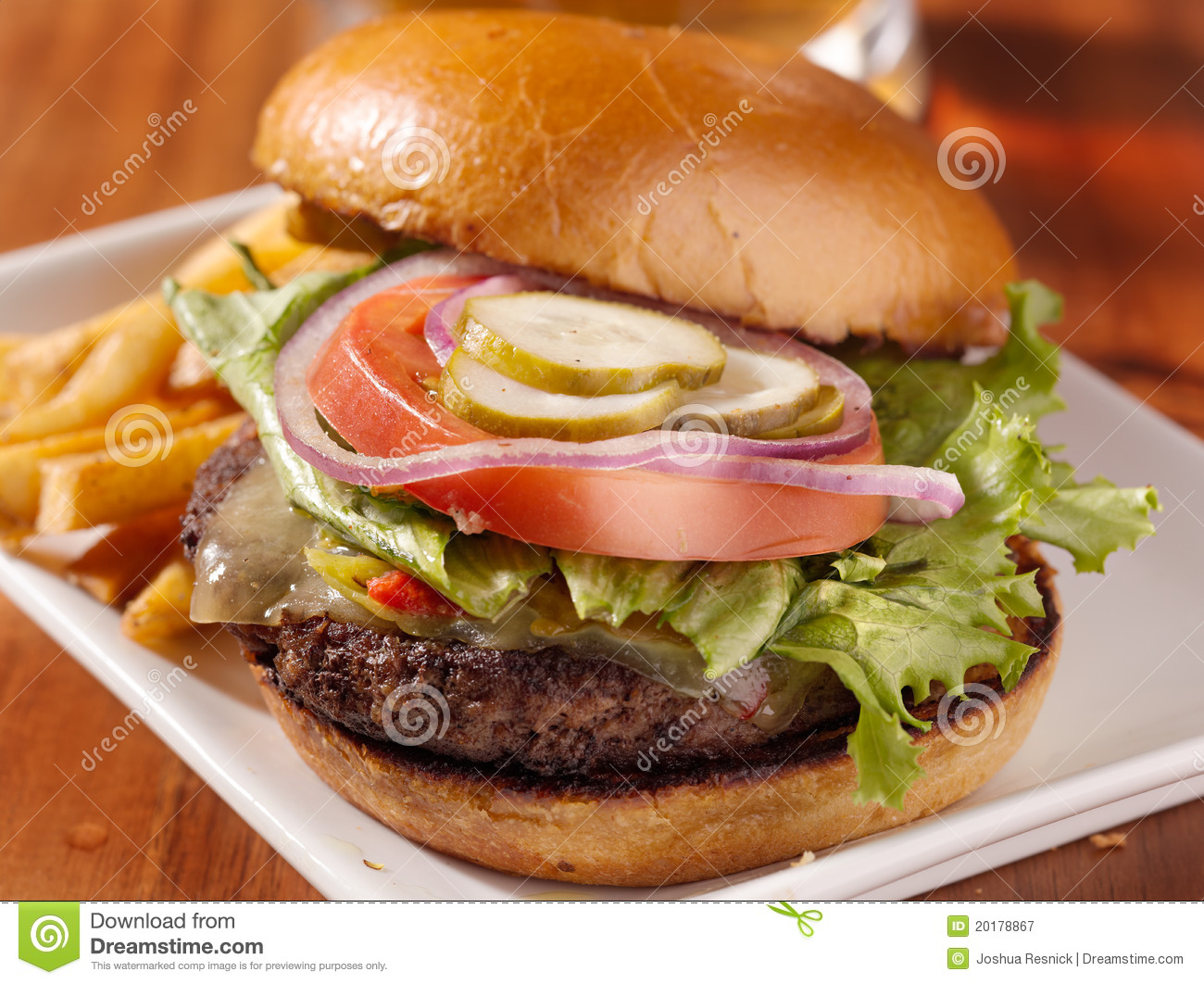 Royalty Free Stock Photography  Gourmet cheeseburger and friesGourmet Cheeseburgers