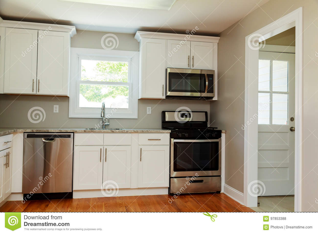 Gourmet Kitchen Features White Shaker Cabinets With Marble Countertops Stock Photo Image Of Cabinets Furnished 97853388