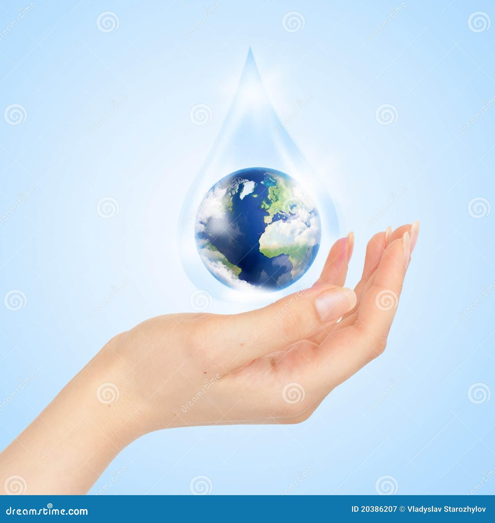 Goutte de l 39 eau avec l 39 int rieur et la main de la terre for L interieur de la terre