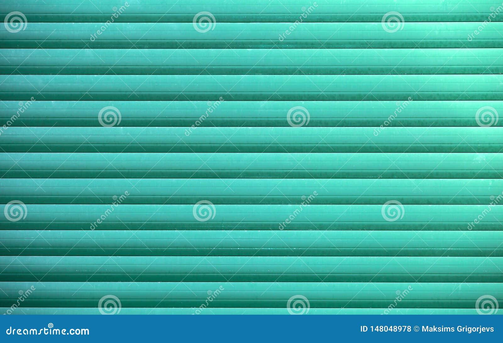 Grön slutaredörr eller stålrulldörr, metallbakgrund