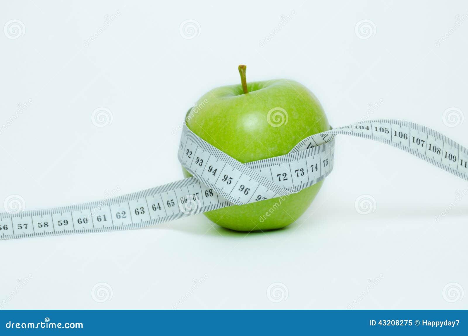 Download Grönt äpple och cm fotografering för bildbyråer. Bild av vegetarian - 43208275