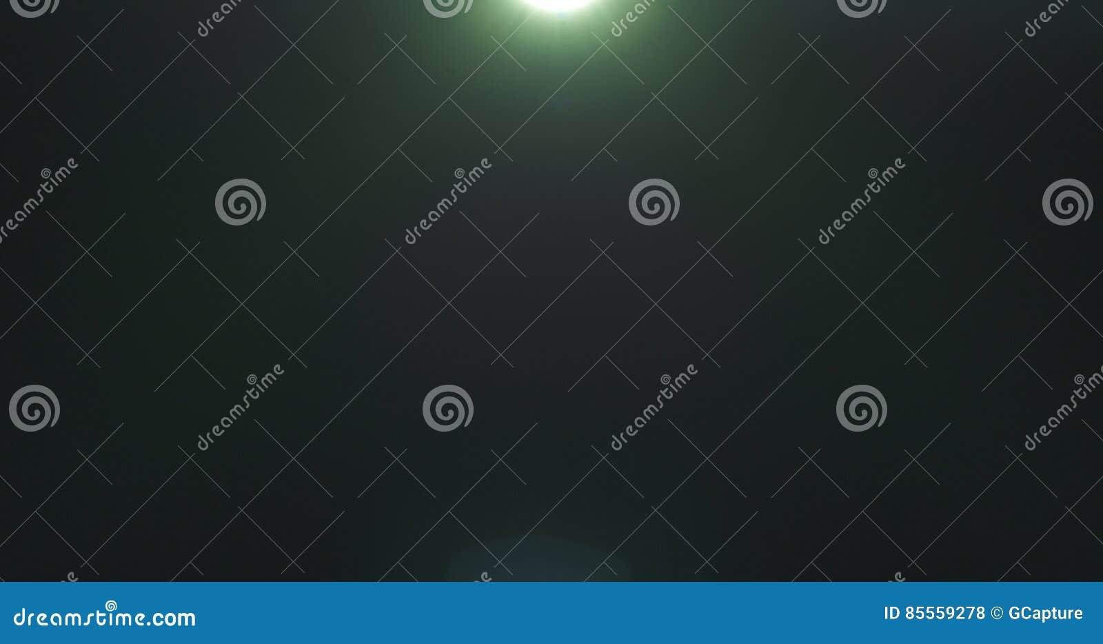 Grüne Blendenfleckartefakte über schwarzem Hintergrund für Überlagerung