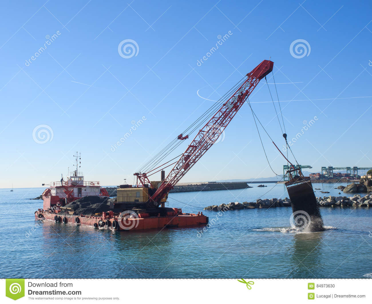 Grab Dredge With Clamshell Bucket Unloading Gravel To