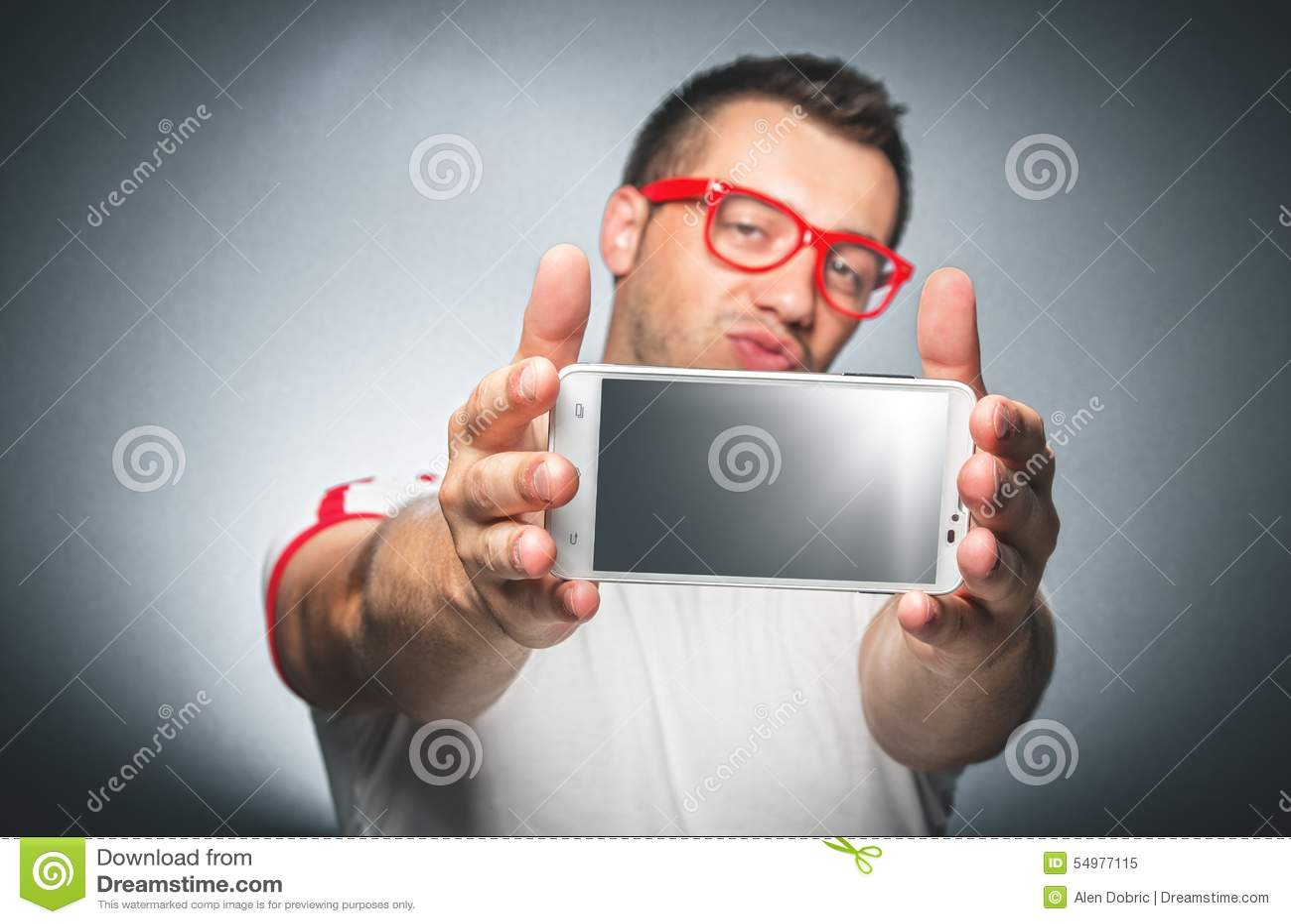 Grabb med mobiltelefonen