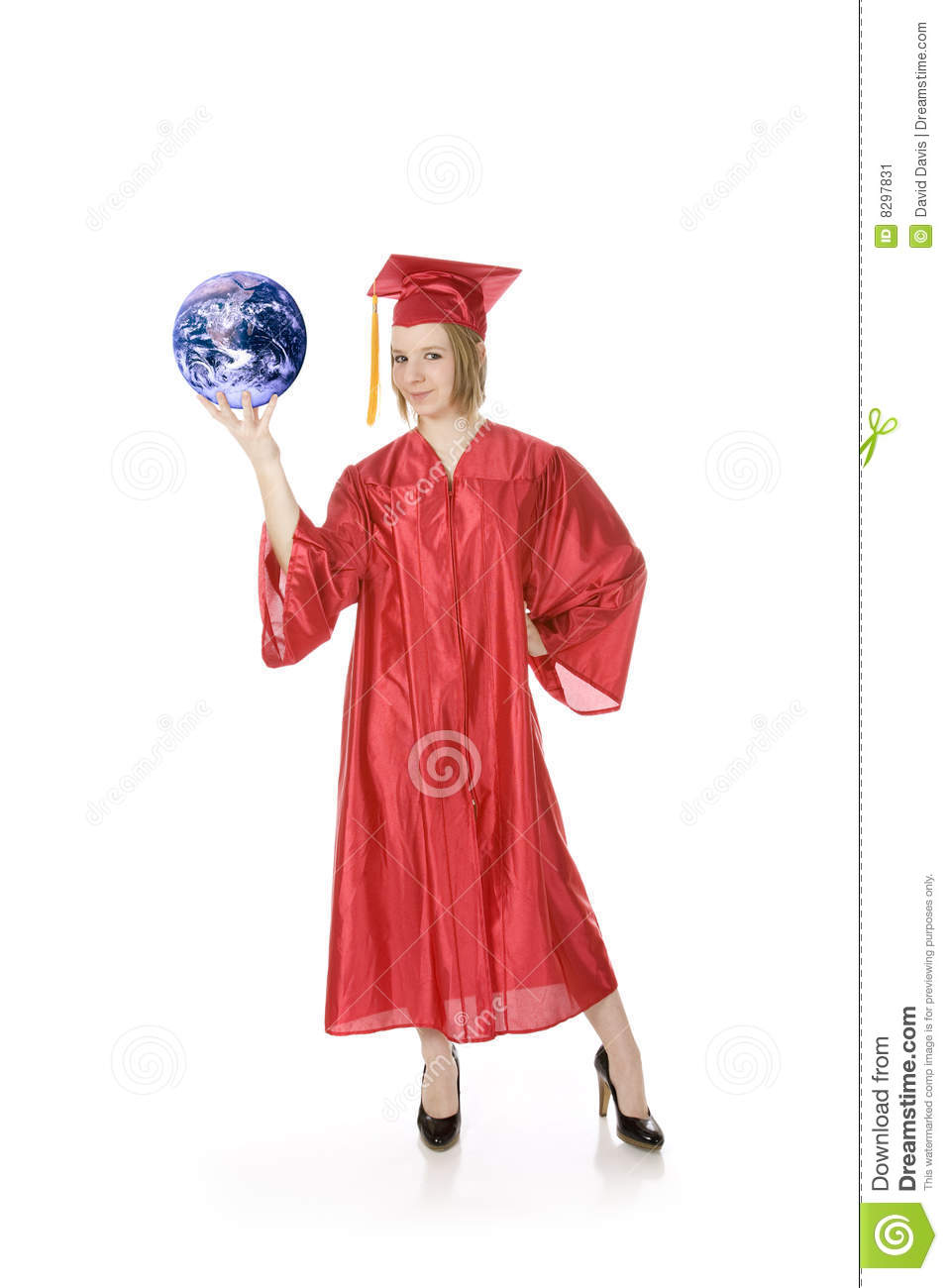 Caucasian Teenager Wearing A Graduation Gown Holding The Earth Stock ...
