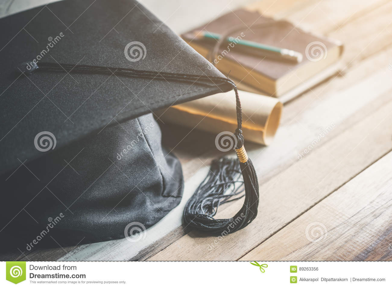 graduation cap, hat with degree paper on wood table graduation c