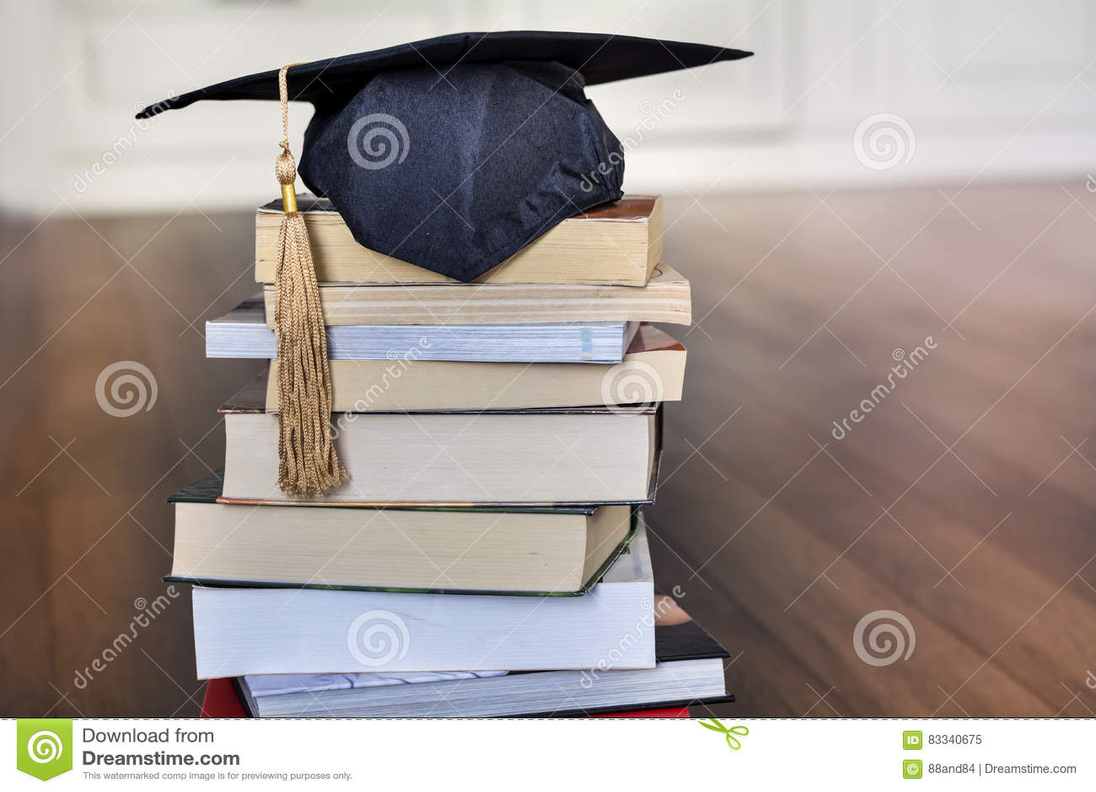 Graduation hat on books