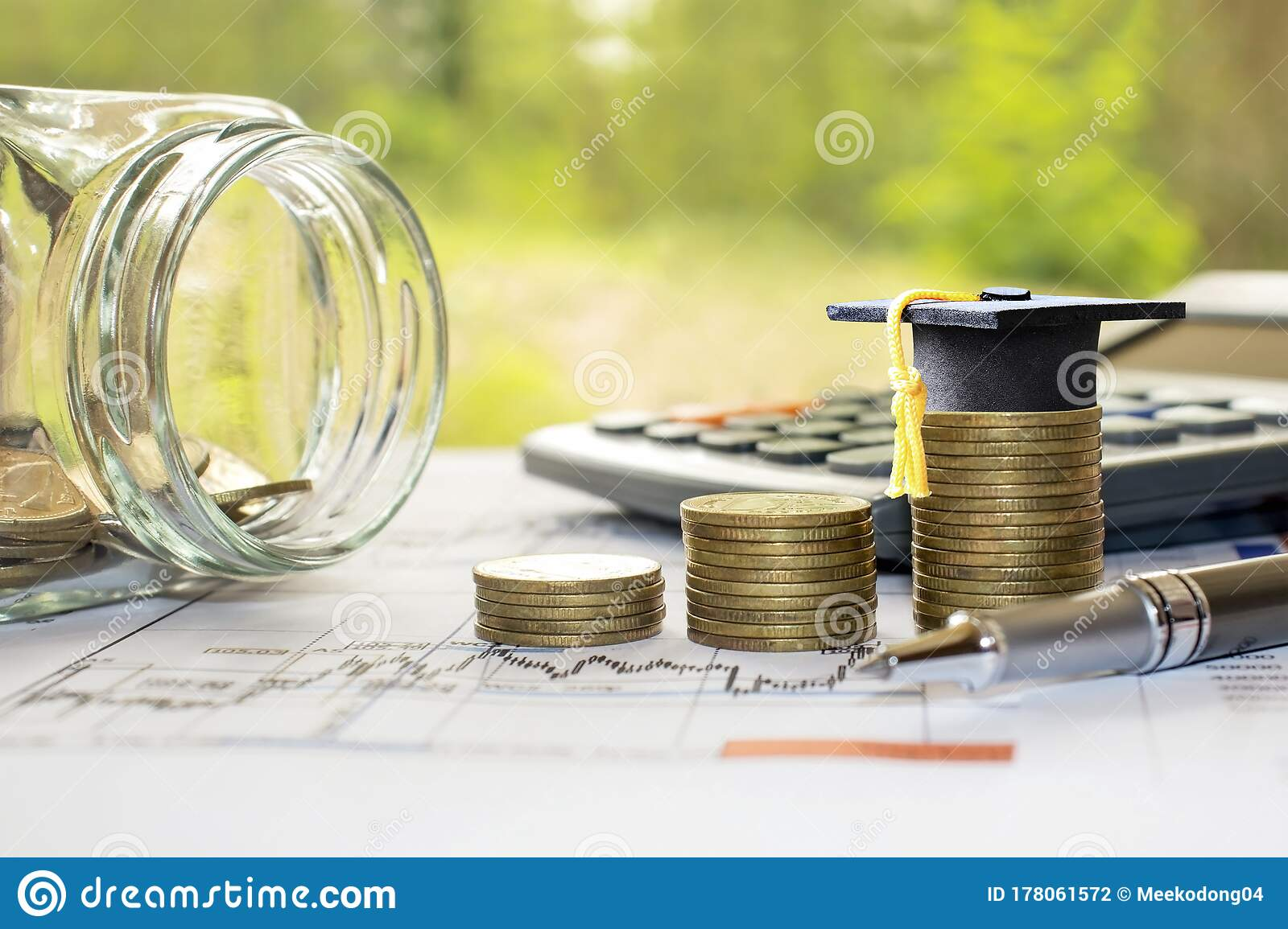 Graduation Hats On A Pile Of Coins And A Money Jar With The Idea Of Saving Money For Education Stock Photo Image Of Coin Achievement 178061572
