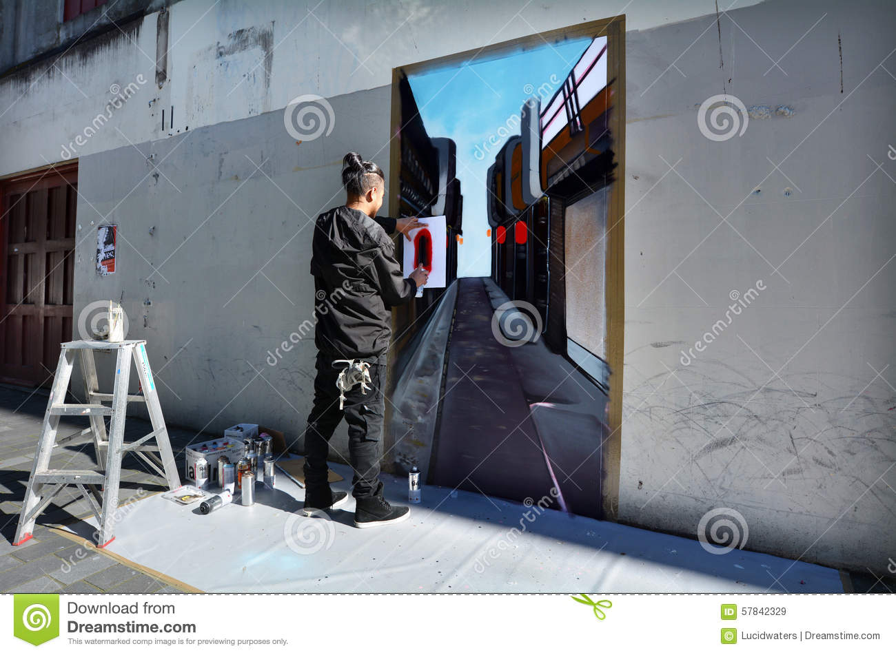 Graffiti artist paint a mural on a wall editorial stock image graffiti artist paint a mural on a wall amipublicfo Image collections