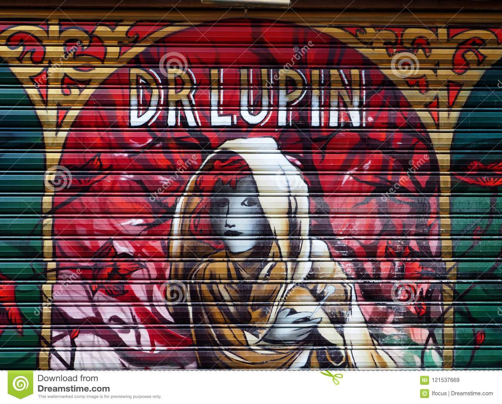 Graffiti Covering A Bars Roller Shutters In Paris