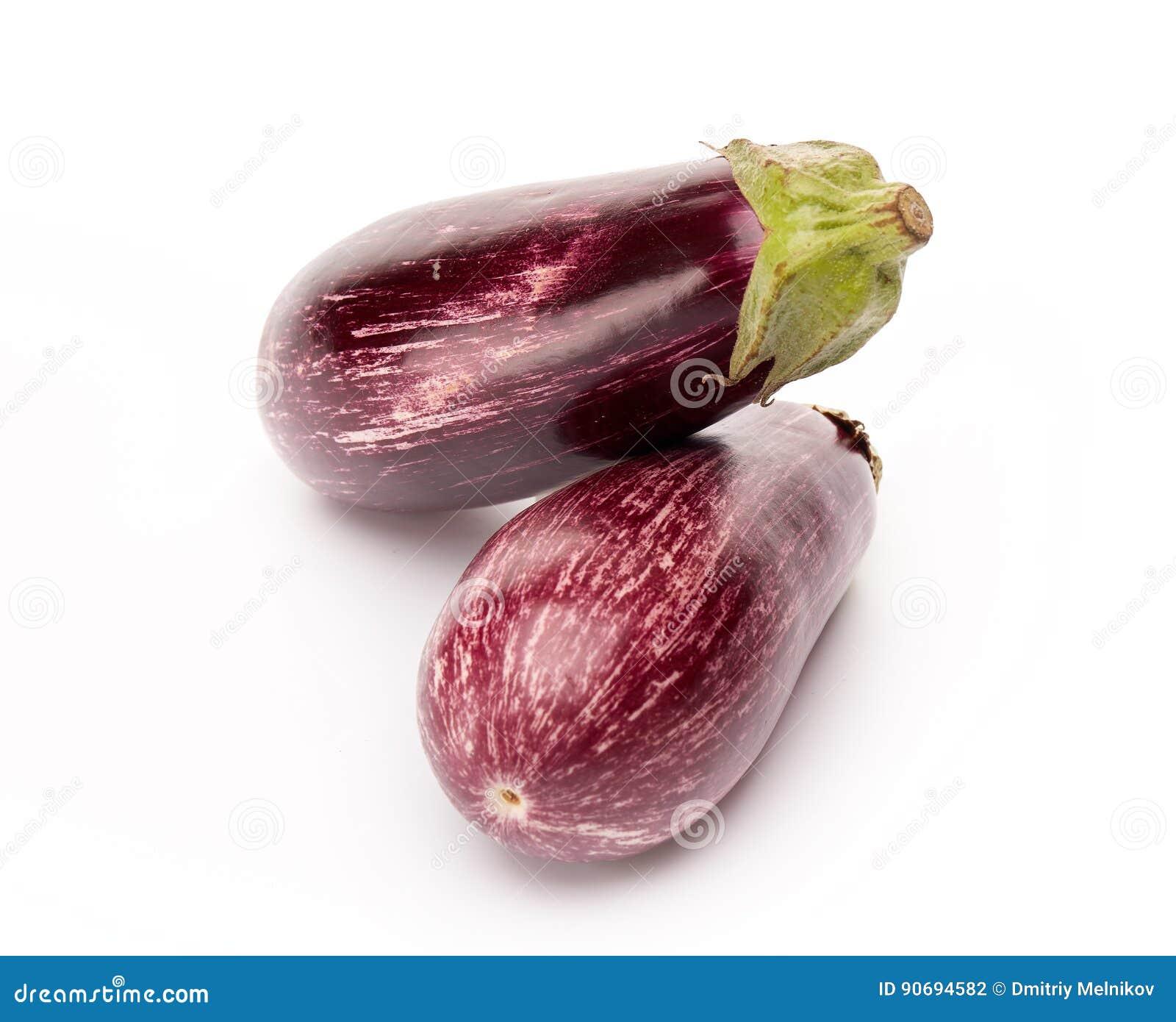Two fresh graffiti eggplants aubergine on a white background