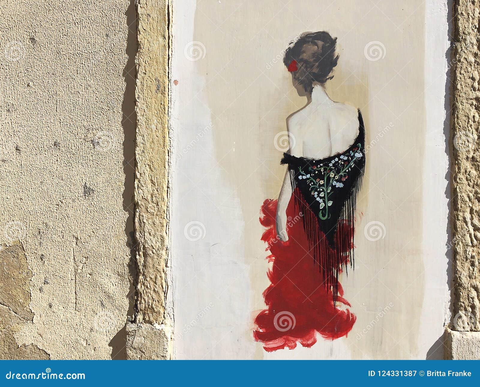 Graffiti einer Fadofrau in den Straßen von Lissabon