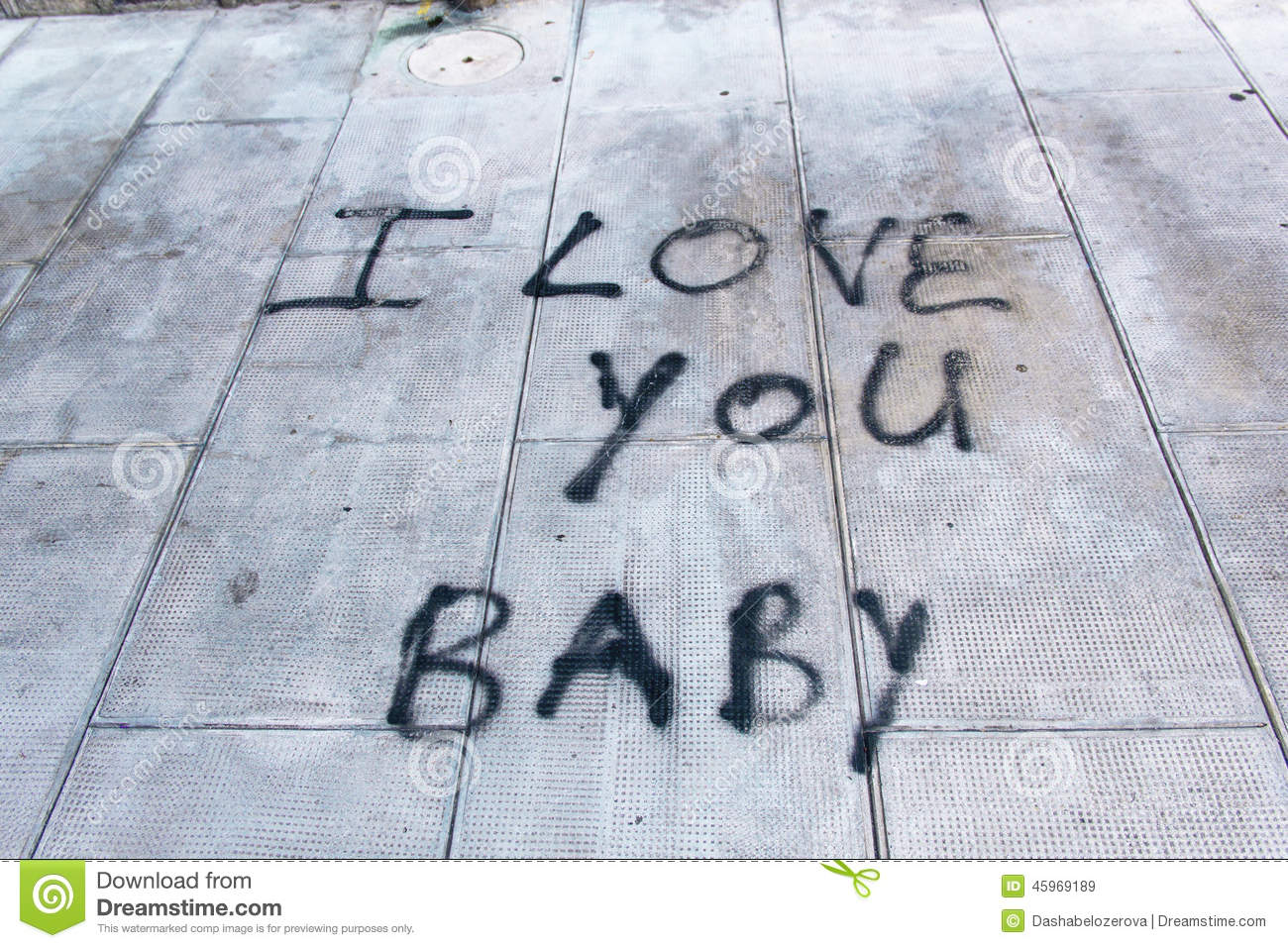 Graffiti on sidewalk i love you baby at day royalty free stock images