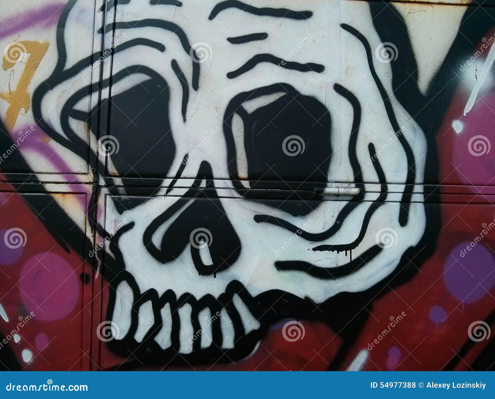 Graffity av skallen på väggtexturen