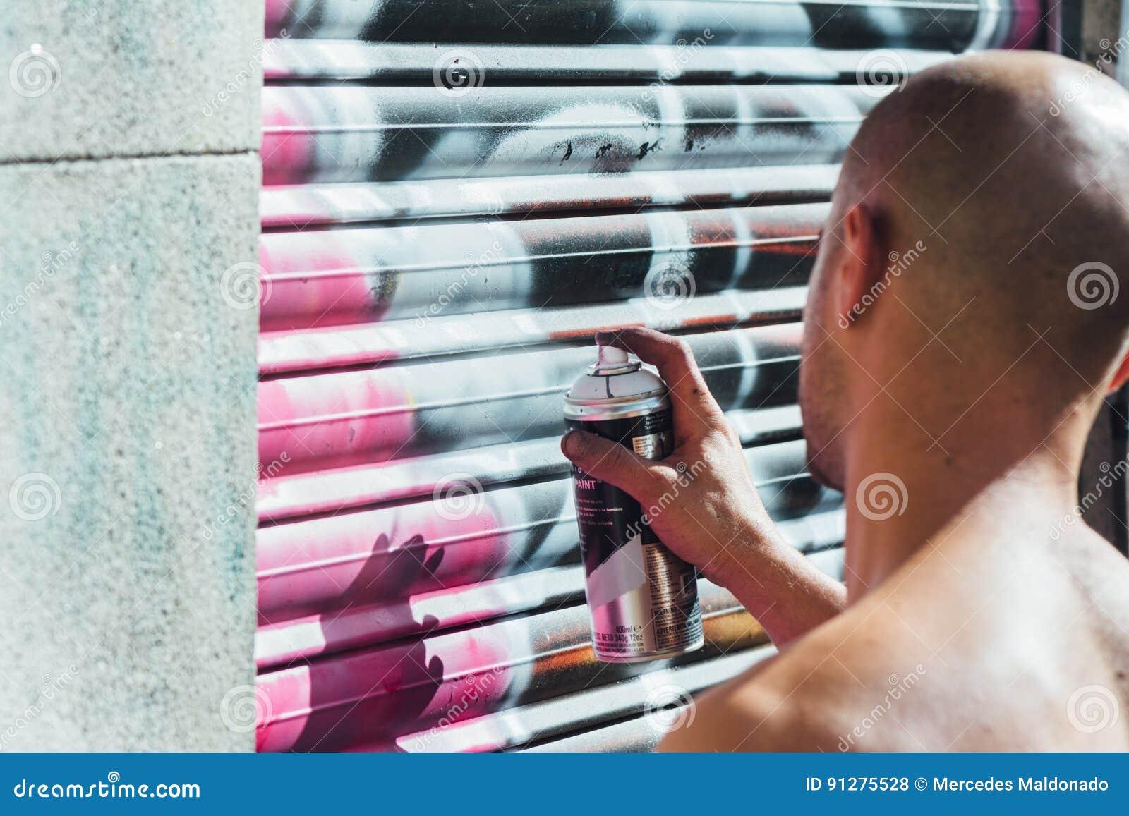 Grafittipojke, sprejmålning i gatan