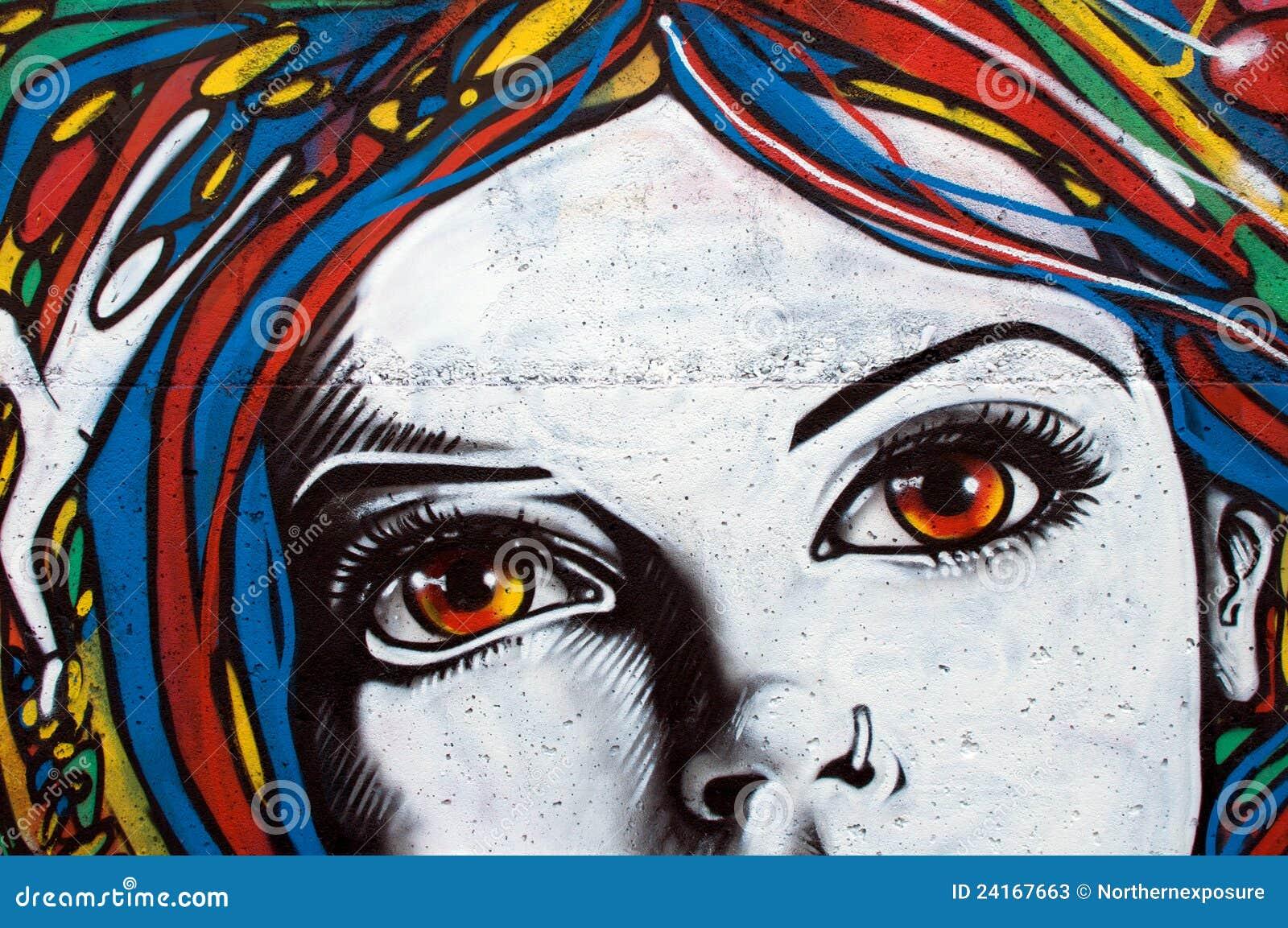 Grafittis modernos do estilo na parede de tijolo
