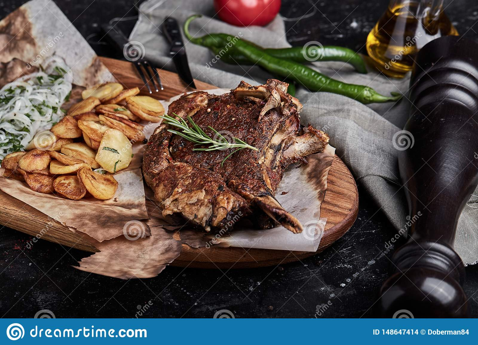 Grain fed Grilled Tomahawk Beef steak with fried potato wedge