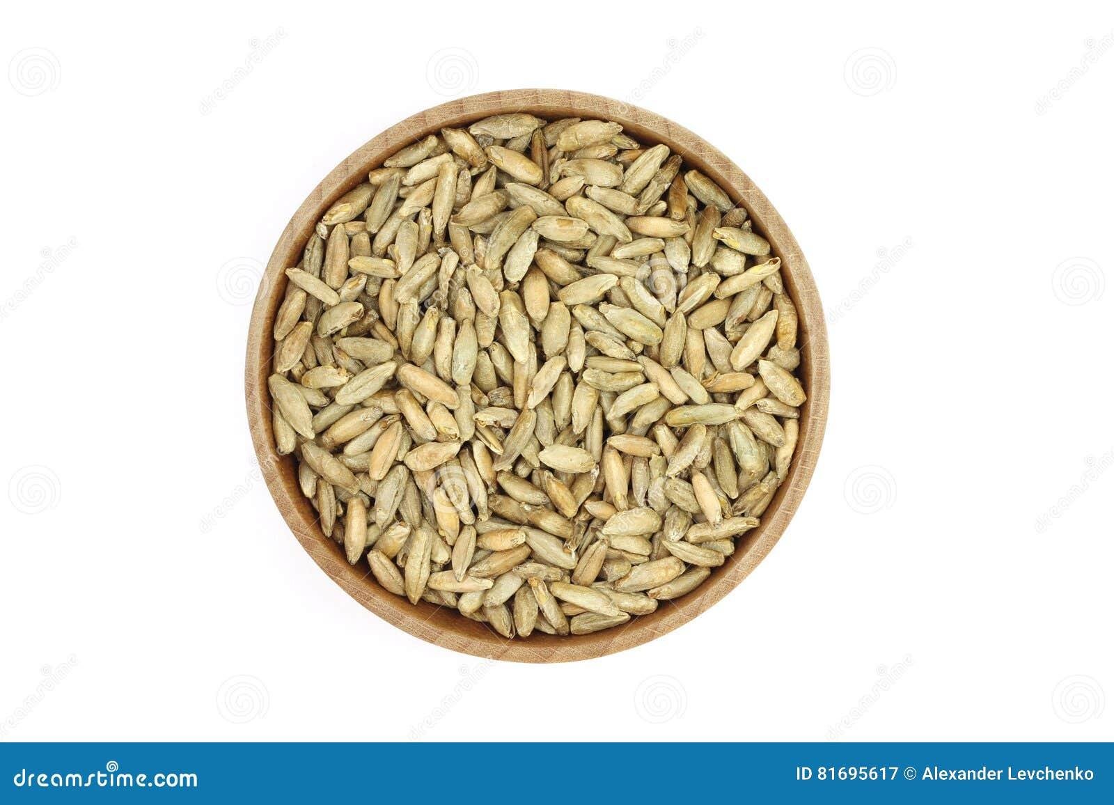 Grain rye malt in a wooden container