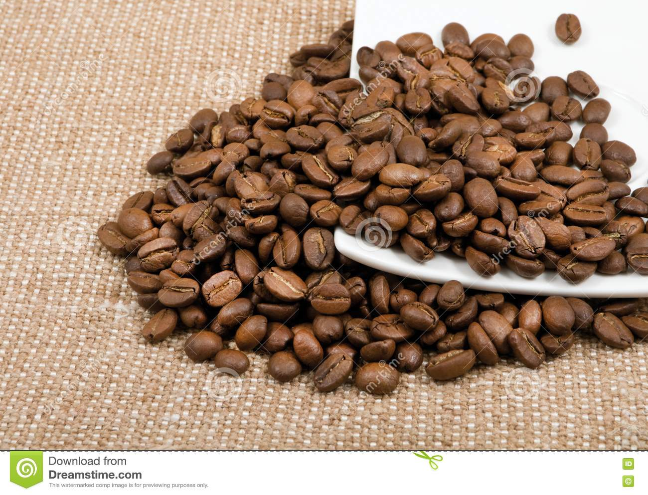 grains of coffee lie on a saucer royalty free stock photo image 23034525. Black Bedroom Furniture Sets. Home Design Ideas