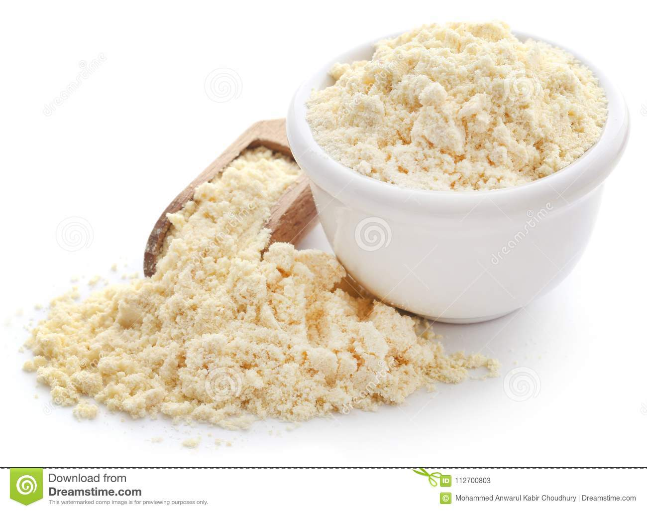 Gram flour in bowl and wooden scoop