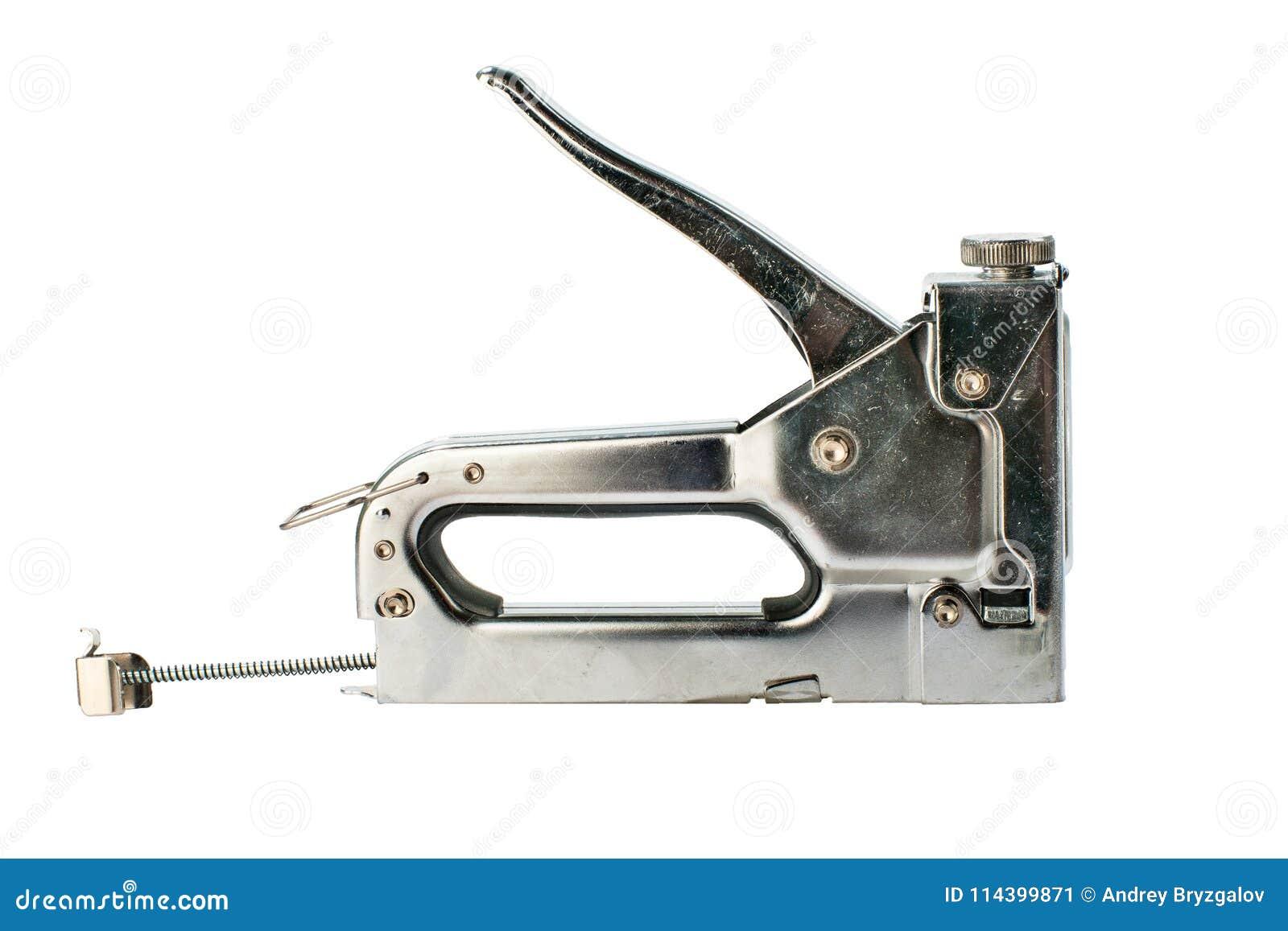 Grampeador da construção de Chrome isolado no fundo branco