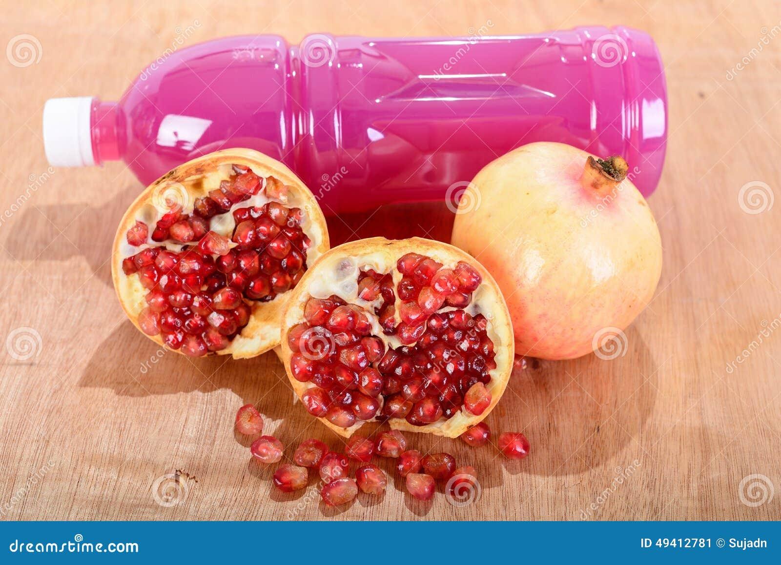 Download Granatapfelsaft Und -früchte Stockbild - Bild von exotisch, makro: 49412781