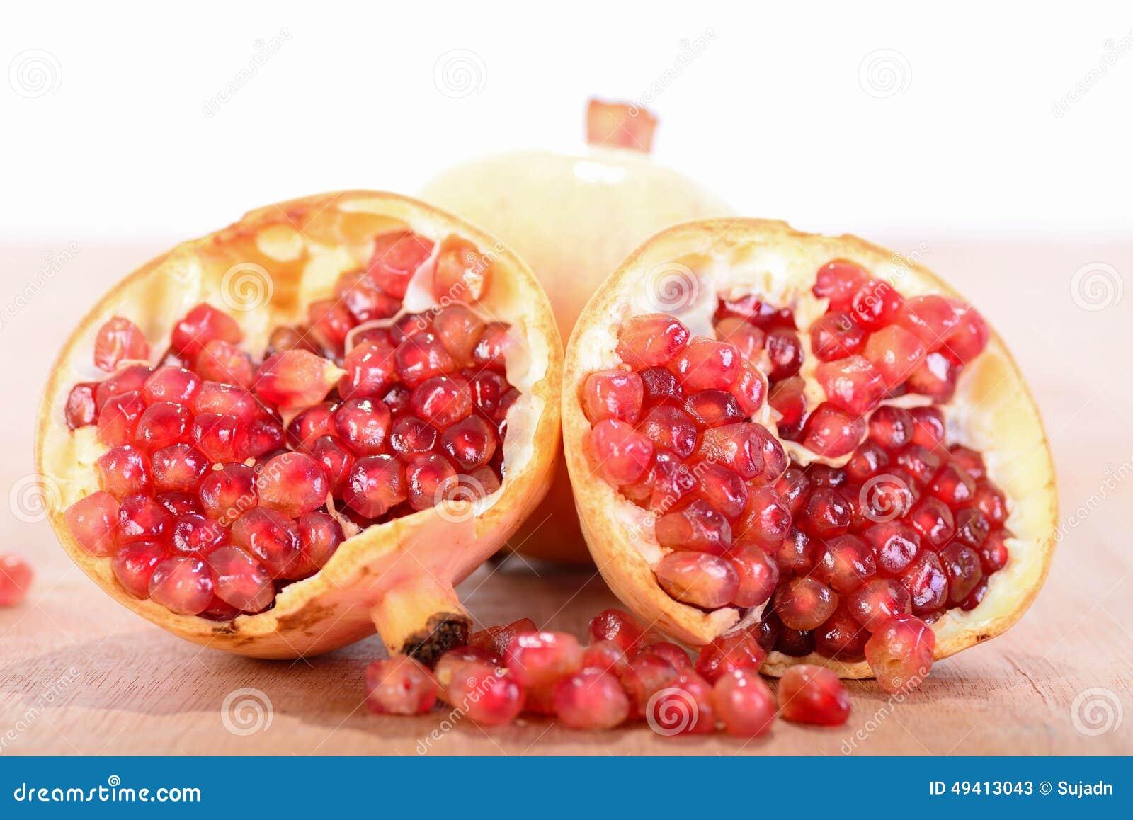 Download Granatapfelsaft Und -früchte Stockbild - Bild von nahrung, farbe: 49413043