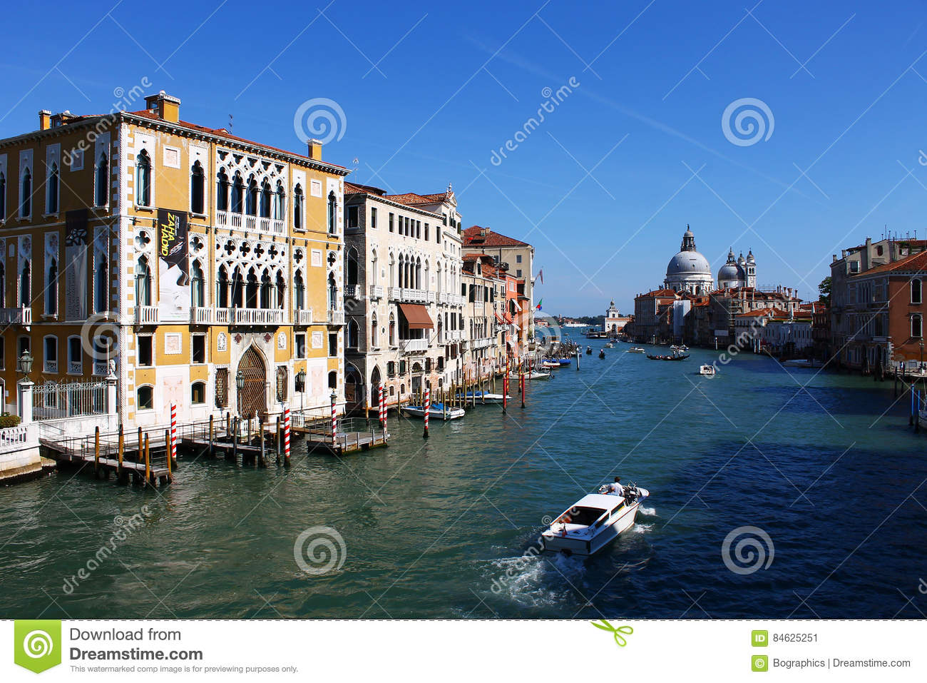 Grand Canal with authentic Venetian buildings and docks