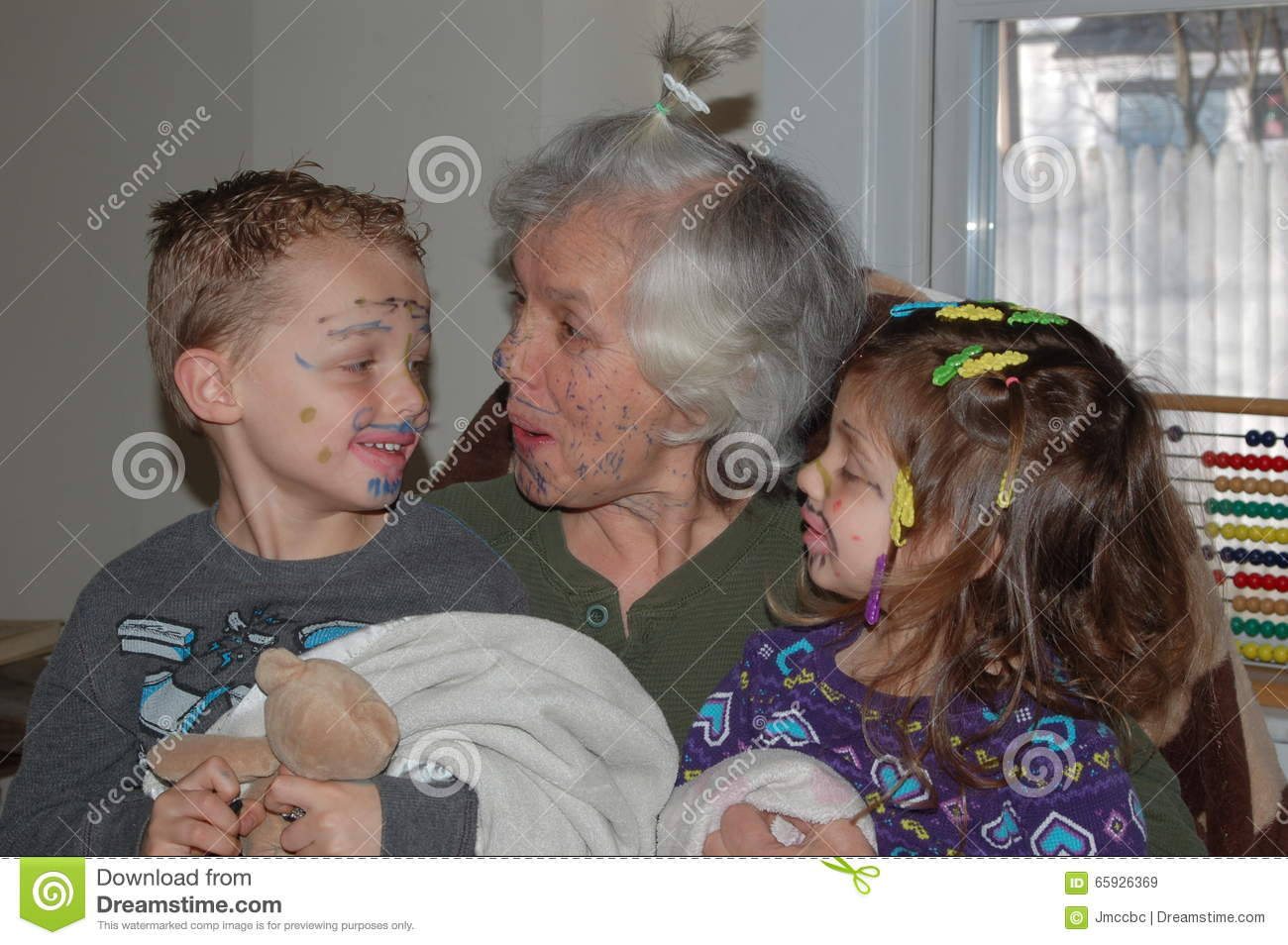 Grandchildren Painting Faces with Grandmother