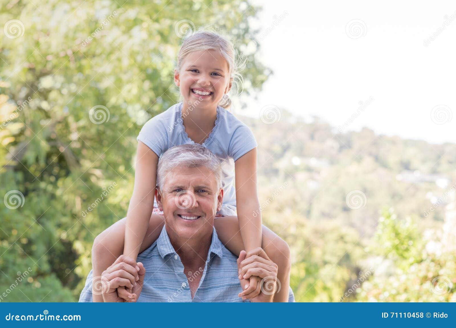 Beauty and senior grandpa on granddaughter