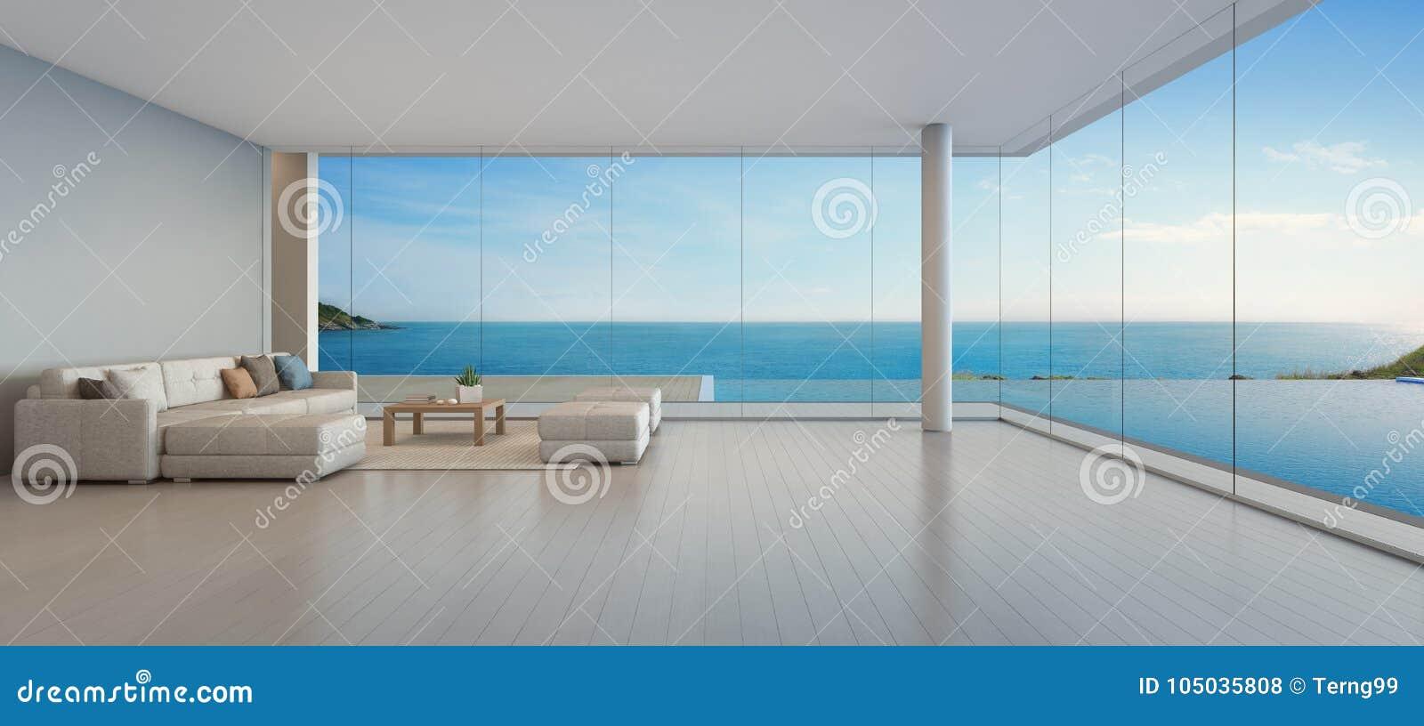 Grande Sofa No Assoalho De Madeira Perto Da Janela De Vidro E
