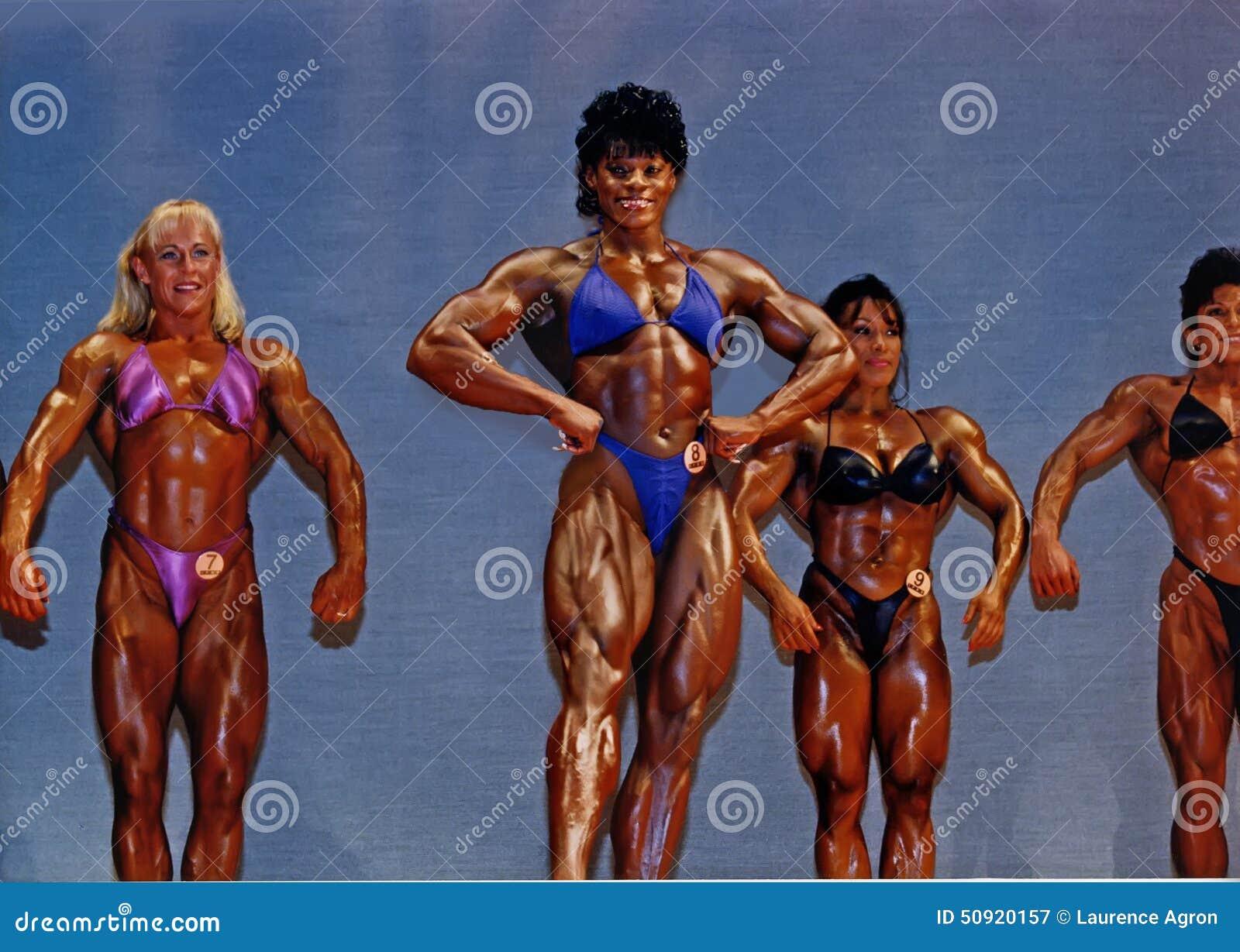 Grandes, halterofilistas definidos das mulheres