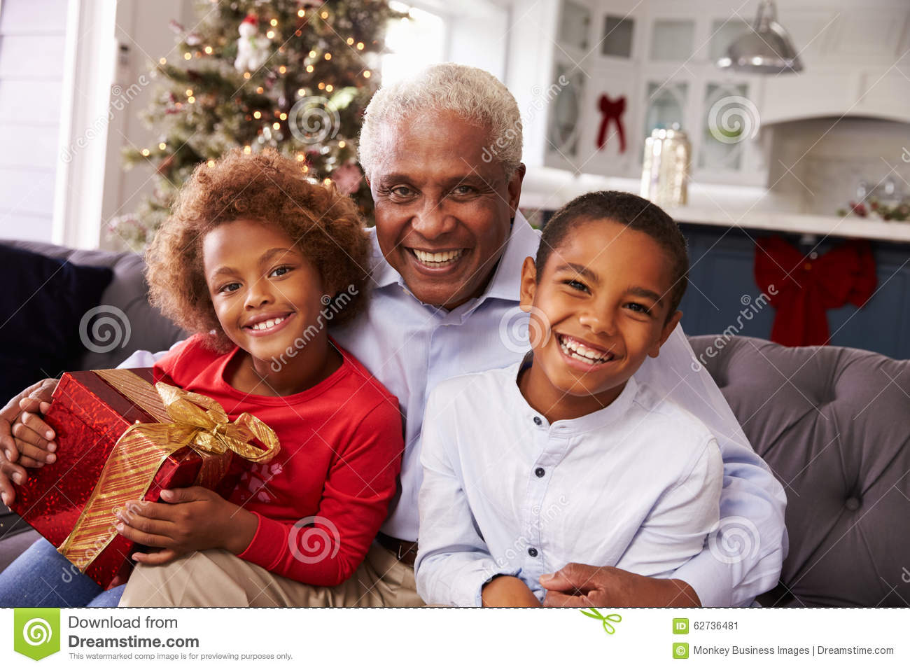 Grandfather With Grandchildren Opening Christmas Gifts Stock Image ...
