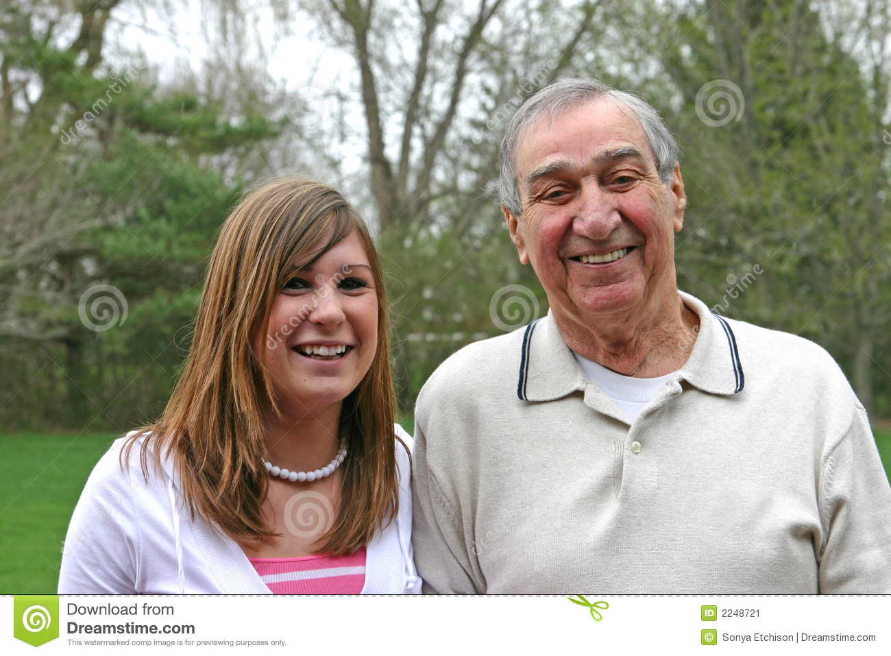 Grandfather and granddaughter reading book ⬇ Stock Photo
