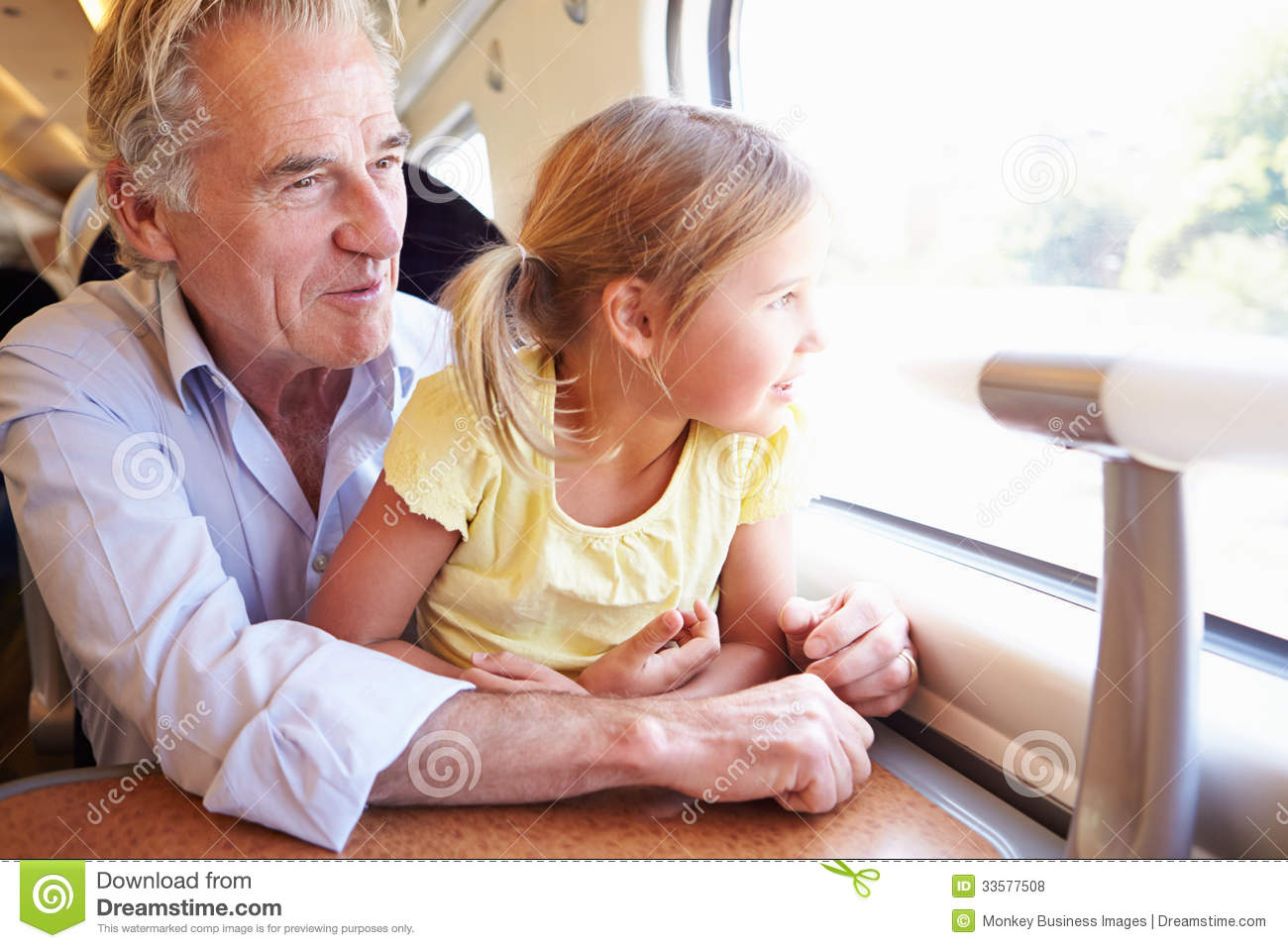 Grandfather And Granddaughter Relaxing On Train Journey Royalty Free ...