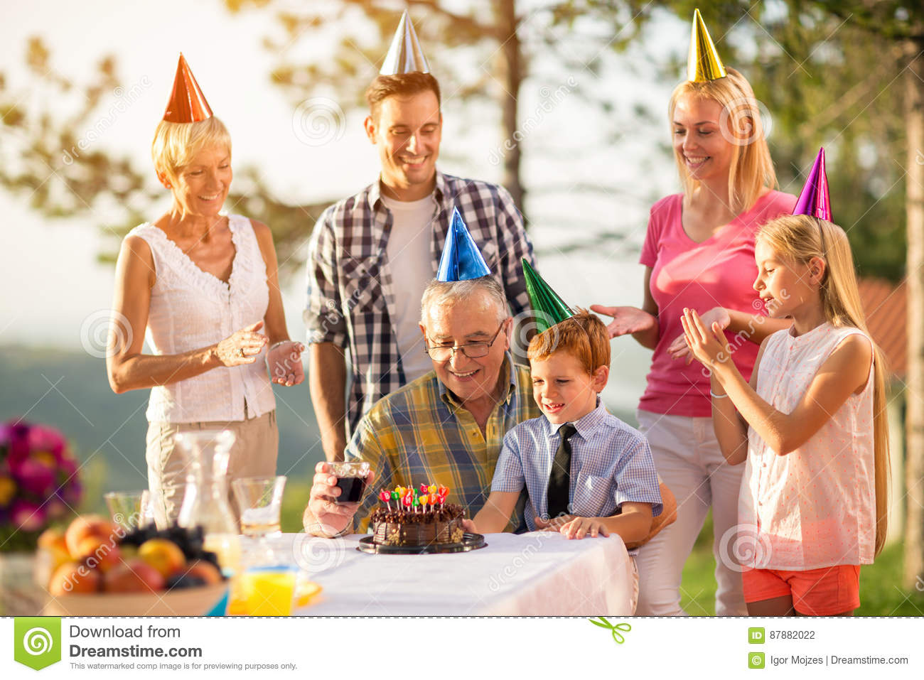 Grandfather and grandson on birthday party celebration